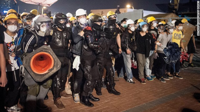 Pro-democracy protesters push police back as they advance on Lung Wo Road outside Hong Kong's Government complex on November 30.