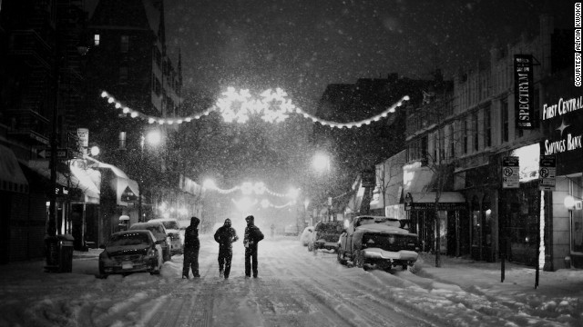 <a href='http://ireport.cnn.com/docs/DOC-1077804'>Alicia Kwoka </a>captured this shot in January of pedestrians in the streets of Queens in the midst of a steady snowfall. Kwoka said the peaceful street was a stark contrast to the usually busy New York environment.