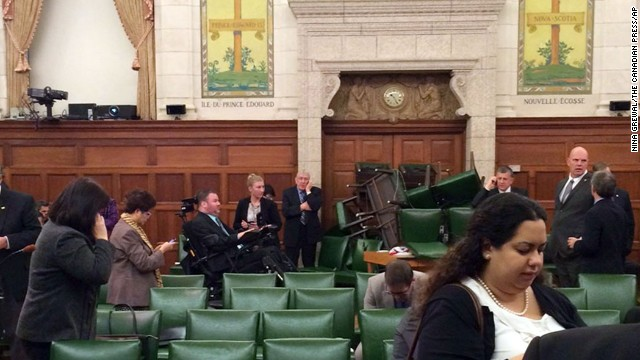 <strong>October 22:</strong> In this photo provided by Canadian politician Nina Grewal, members of Canada's Parliament barricade themselves in a meeting room after shots were fired on Parliament Hill in Ottawa. <a href='http://www.cnn.com/2014/10/22/world/gallery/canada-shooting-parliament/index.html'>A Canadian soldier was fatally shot at the National War Memorial nearby,</a> police said, and the alleged gunman was killed.