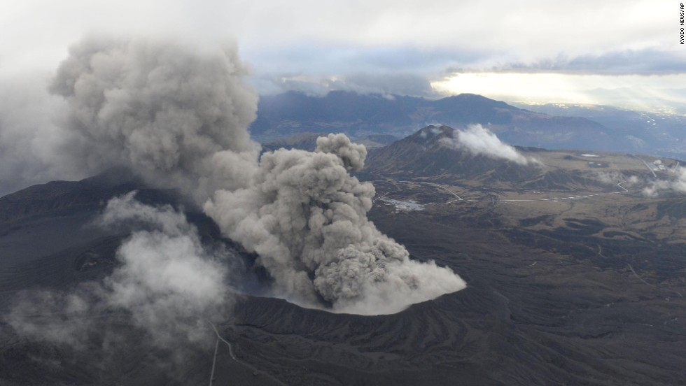 Volcanic smoke billows from Mount Aso on the southern Japanese island of Kyushu on Wednesday, November 26. The volcano is blasting out chunks of magma in its first eruption in 22 years, prompting flight cancellations and warnings to stay away from its crater.