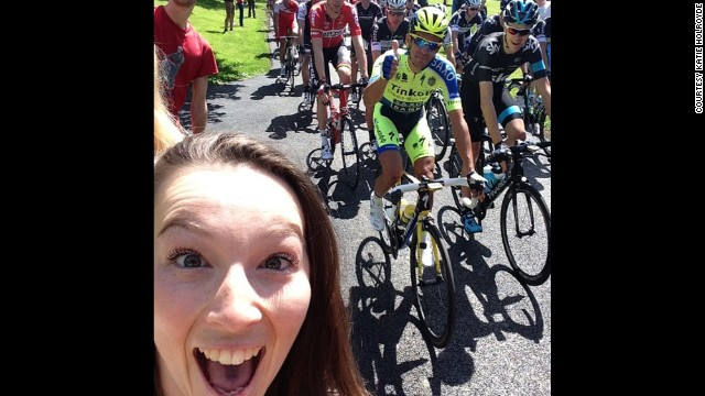 Cyclist Alberto Contador gives a thumbs-up while fan Katie Holroyde <a href='http://instagram.com/p/qEiCoWSNal/?modal=true' target='_blank'>takes a selfie</a> Saturday, July 5, at the start of the Tour de France in Leeds, England. One of the Tour's charms has been allowing fans to get close to the action for free, but some cyclists this year <a href='http://edition.cnn.com/2014/07/07/sport/tour-de-france-britain-selfies-kittel/'>have complained about fans taking selfies</a> and not paying attention to the dangers they pose.