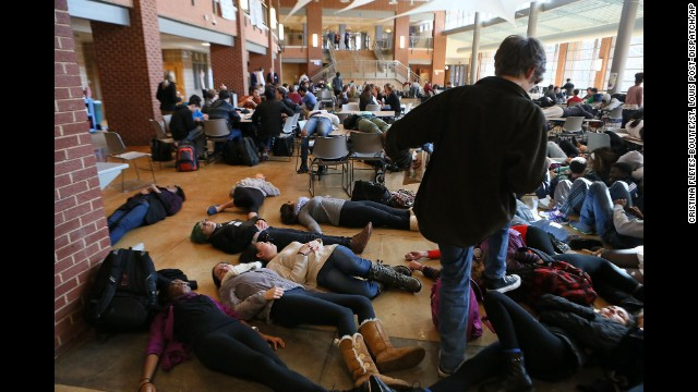 "Students at Clayton High School in Clayton, Missouri, take part in a ""die-in"" protest in the school cafeteria on December 1."