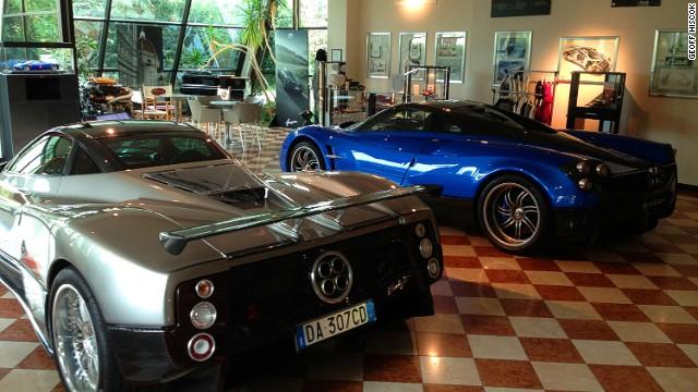 Pagani Zonda F (left) and Huayra models at the showroom of supercar newcomer Pagani, in San Cesario sul Panaro.
