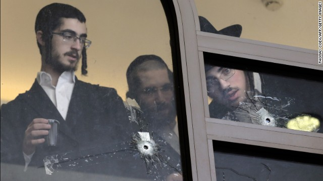 <strong>November 18:</strong> Men look at bullet holes on the main window of a Jerusalem synagogue that was attacked by two Palestinian men. <a href='http://www.cnn.com/2014/11/18/middleeast/gallery/jerusalem-synagogue-attack/index.html'>Four worshippers and a police officer were killed and several others were wounded</a> in the deadliest terror attack in Jerusalem since 2008.