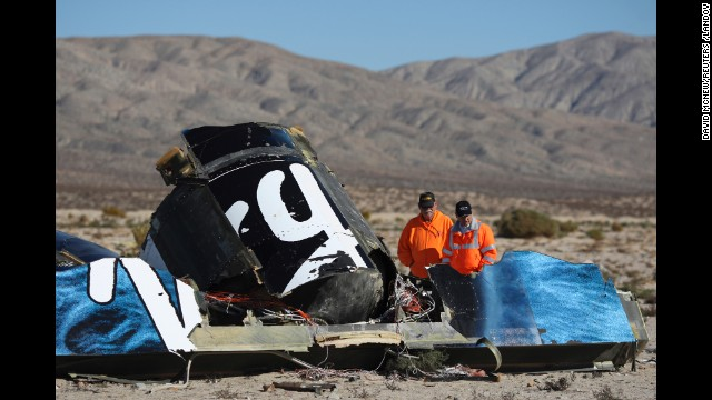 <strong>November 2:</strong> Sheriff's deputies near Cantil, California, look at the wreckage of Virgin Galactic's SpaceShipTwo. <a href='http://ift.tt/1DMFN1P'>The space plane disintegrated in the air</a> just two minutes after it separated from the jet-powered aircraft that carried it aloft. The accident killed co-pilot Michael Tyner Alsbury and injured co-pilot Peter Siebold, who managed to parachute to the ground.