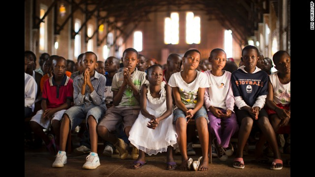 <strong>April 6:</strong> Children pray at a Catholic church in Kigali, Rwanda. Twenty years ago, <a href='http://cnnphotos.blogs.cnn.com/2014/04/03/like-being-in-the-valley-of-death/'>mass killings began</a> in Rwanda. An estimated 800,000 civilians, mostly from the Tutsi ethnic group, were murdered over a period of about 100 days.