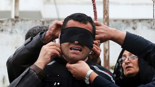 <strong>April 15:</strong> The parents of Abdollah Hosseinzadeh remove a noose from the neck of his convicted killer, a man identified only as Balal, before Balal was to be hanged in Noor, Iran. Balal killed Hosseinzadeh during a street fight in 2007, according to the semi-official Iranian news agency ISNA. But just seconds before Balal was to be hanged, <a href='http://www.cnn.com/2014/04/17/world/meast/iran-execution-photos-mother-forgives/index.html'>he was forgiven by Hosseinzadeh's mother.</a>