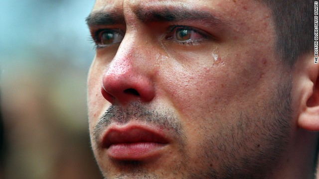 <strong>April 15:</strong> Boston University student Sebastian Filgueira-Gomez has tears in his eyes during a moment of silence for the<a href=