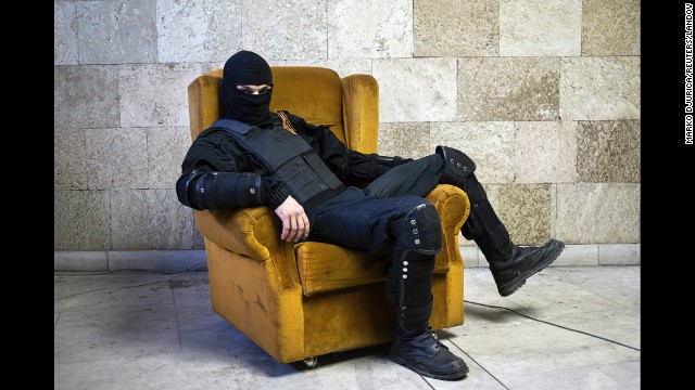 <strong>April 25:</strong> A pro-Russian rebel poses for a picture inside a regional government building in Donetsk, Ukraine, on Friday, April 25. <a href='http://www.cnn.com/2014/08/07/europe/gallery/ukraine-crisis/index.html'>Fighting between Ukrainian troops and pro-Russian rebels in the country</a> has left more than 3,000 people dead since mid-April, according to the United Nations.