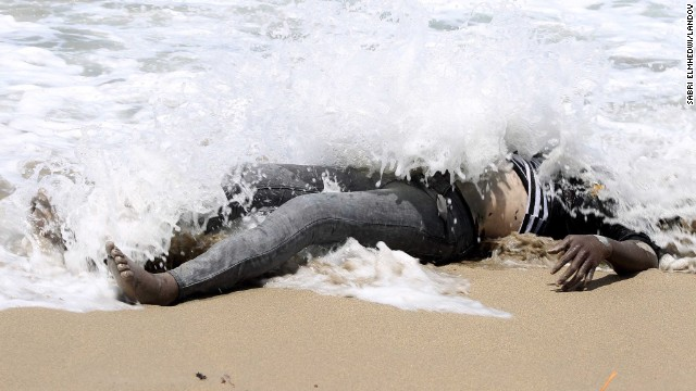 <strong>May 14:</strong> The body of an illegal migrant lies on the shore of al-Qarboli, Libya. Libyan officials said at least 40 people died and around 50 were rescued when <a href='http://www.cnn.com/2014/05/11/world/meast/libya-boat-migrants/index.html'>a boat carrying mostly sub-Saharan migrants sank off the coast of Tripoli</a> on May 11.
