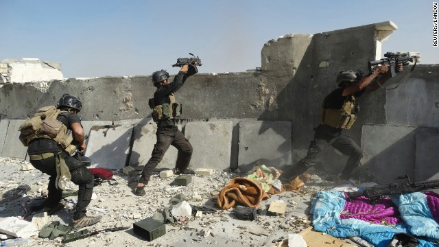 <strong>June 19:</strong> Members of Iraq's Special Operations Forces take their positions during clashes with the ISIS militant group Thursday, June 19, in Ramadi, Iraq. ISIS <a href='http://www.cnn.com/2014/06/13/world/gallery/iraq-under-siege/index.html'>has been advancing in Iraq and Syria</a> as it seeks to create an Islamic caliphate in the region.