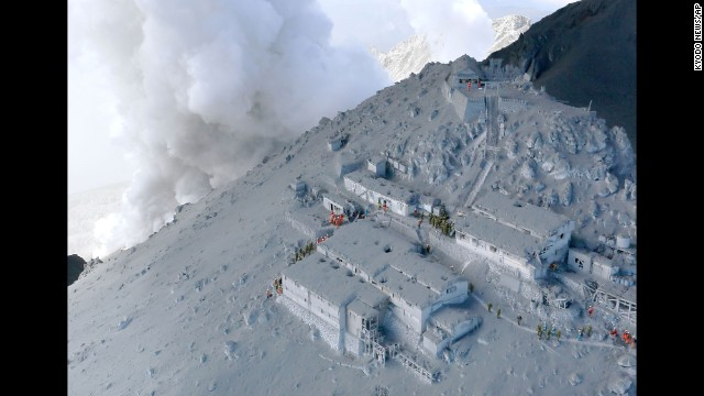 <strong>September 28:</strong> Firefighters and members of Japan's military conduct a rescue operation at a cabin near the peak of Mount Ontake. Dozens of people were killed <a href='http://www.cnn.com/2014/09/27/world/gallery/mount-ontake-erupts/index.html'>when the volcano erupted</a>.