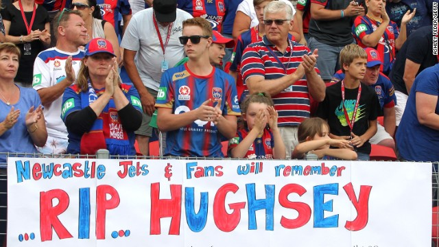 Newcastle fans applaud in memory of Phil Hughes at the 63 minute mark during the an A-League soccer match between the Newcastle Jets and Central Coast Mariners on November 30 in Newcastle, Australia. Hughes' was injured while on 63 not out, charging the number with symbolism for mourners.