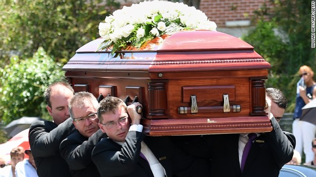 Pallbearers carry the coffin of Australian batsman Phil Hughes ahead of his funeral in his home town of Macksville in northern New South Wales on December 3.