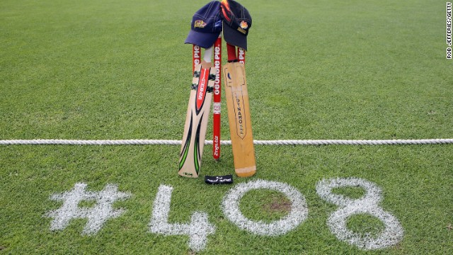 New Zealand cricket teams the Otago Volts and Wellington Firebirds place a bat, cap and black armband on the University Oval in Dunedin in memory of Australian cricketer Phil Hughes. Hughes was the 408th player to play Test cricket for Australia when he made his debut in 2009.