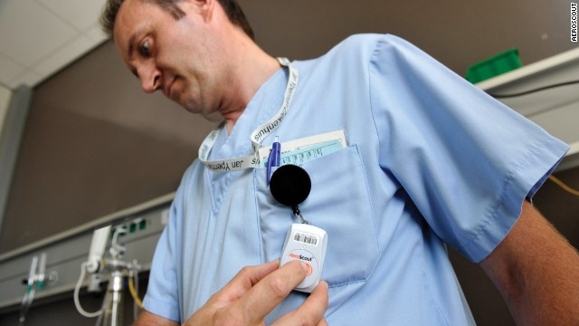 Nurse models tracking tag from Aeroscout.