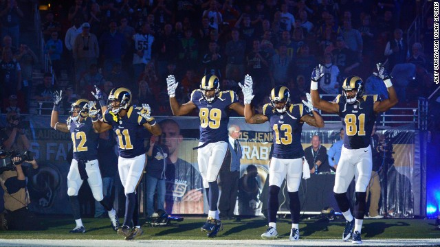 <strong>November 30:</strong> From left, St. Louis Rams Stedman Bailey, Tavon Austin, Jared Cook, Chris Givens and Kenny Britt put their hands up before playing the Oakland Raiders in St. Louis. <a href='http://ift.tt/1rNOH9T'>The gesture</a> was meant to show support for Michael Brown, the teenager who was killed in the St. Louis suburb of Ferguson.