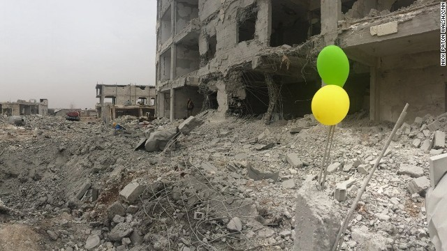 """""""Every time you open your eyes in Kobani, you see the damage,"""" writes CNN's Nick Paton Walsh. """"There are people still there, but it is hard to gauge how many."""""""