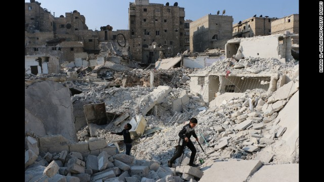 Syrian boys play in the ruins of a destroyed building in Aleppo on Tuesday, November 18.