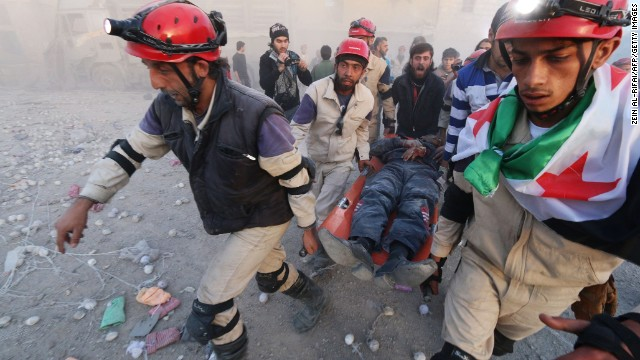 Members of the Syrian Civil Defense carry an injured man after an alleged air strike in Aleppo on November 11.
