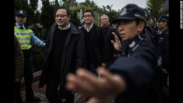 The three co-founders of the Occupy Central movement -- from left, Benny Tai Yiu-ting, Chan Kin-man, and the Rev. Chu Yiu-ming -- surrender to authorities in Hong Kong on Wednesday, December 3.