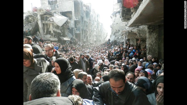 <strong>January 31:</strong> Refugees at the besieged al-Yarmouk camp, south of Damascus, Syria, wait to receive food distributed by the U.N. Relief and Works Agency. Millions of people <a href='http://www.cnn.com/2013/03/05/world/gallery/syrian-refugees/index.html'>have either fled Syria or become displaced</a> because of the civil war there.