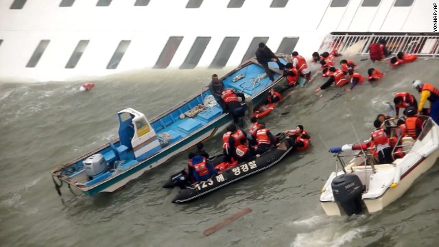 <strong>April 16:</strong> Rescue boats scramble to save passengers from the sinking ferry Sewol as it sinks into freezing waters off South Korea's southwestern coast. More than 300 people died <a href='http://ift.tt/1slu5Gm'>after the ferry capsized,</a> and the ship's captain was later sentenced to 36 years in jail.