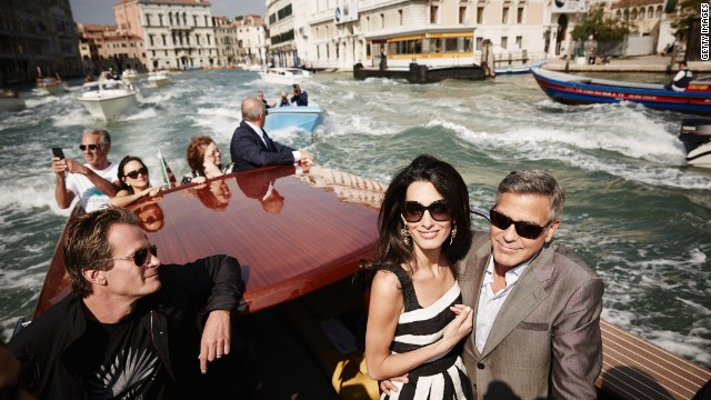 <strong>September 26:</strong> Actor George Clooney, right, and his fiancee, lawyer Amal Alamuddin, arrive in Venice, Italy, on Friday, September 26. The two were married that weekend in a private ceremony <a href='http://www.cnn.com/2014/09/27/showbiz/gallery/clooney-wedding/index.html'>attended by some of their celebrity friends.</a> At left is Rande Gerber, husband of model Cindy Crawford.