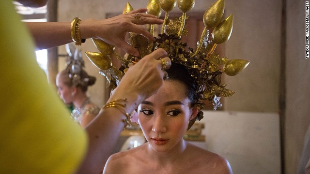 DECEMBER 4 - CHIANG MAI, THAILAND: A Thai women prepares for a parade and ceremony in honor of King Bhumibol Adulyadej's birthday. <a href='http://cnn.com/2014/10/06/world/asia/thailand-king-bhumibol-gallbladder/'>The world's longest-reigning monarch</a> is a deeply revered figure in Thailand, where his portrait hangs in government offices and many homes.