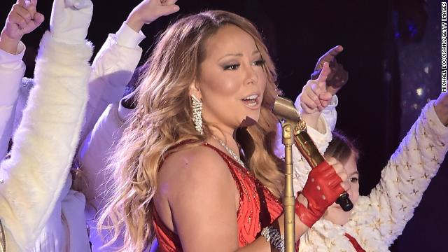 mariah carey performs at the 82nd annual rockefeller christmas tree lighting ceremony at rockefeller center on