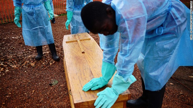 """I think one of the vital things we've failed to adhere to as a people, is not to touch a sick person,"" said Johansen of a disease in which <a href='http://www.who.int/mediacentre/news/notes/2014/ebola-burial-protocol/en/' target='_blank'>20% of transmissions happen during burials.</a> Here, government burial team members wearing protective clothing stand next to the coffin of Dr Modupeh Cole -- Sierra Leone's second senior physician to die of Ebola."