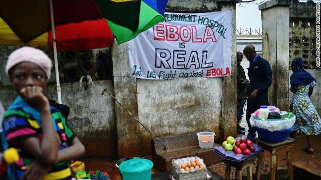 """When someone you love is sick, you want to hold that person, you want to carry them,"" said Johansen. ""But you can't."" In Freetown, a sign warning of the dangers of Ebola hangs outside a government hospital."