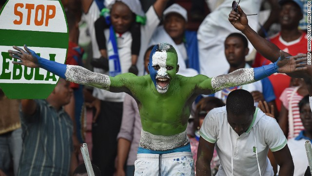 "Football is ""like a second religion in Sierra Leone."" That was before the Ebola outbreak put a stop to organized games, casual kick-abouts, and people gathering to watch the national sport. Here, a fan shows his colors."