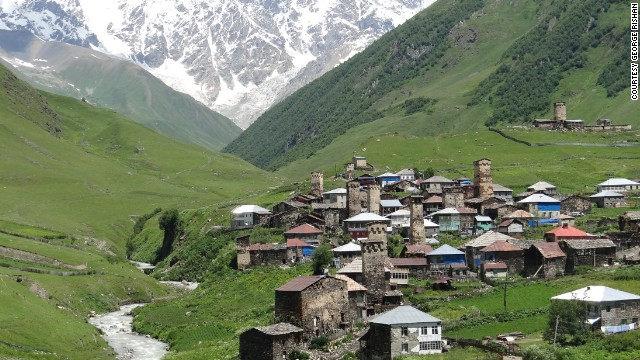 Ancient tower-houses peek out from the village of Ushguli in the Upper Svaneti region of the Caucasus in Georgia. The area was designated as a UNESCO World Heritage site in 1996.
