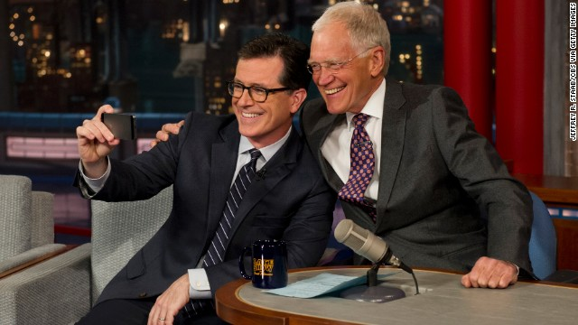 "Funnyman Stephen Colbert, left, takes a selfie with David Letterman on the ""Late Show with David Letterman"" on Tuesday, April 22. It was Colbert's first visit to the show since CBS announced <a href='http://www.cnn.com/2014/04/10/showbiz/gallery/stephen-colbert/index.html'>Colbert would succeed Letterman</a> when Letterman retires in 2015."