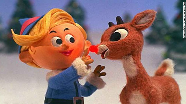 """Rudolph the Red-Nosed Reindeer"" (1964): It's been 50 years since Rankin/Bass's animated ""Rudolph the Red-Nosed Reindeer"" premiered on NBC, and it's still just as beloved. It doesn't quite feel like the holidays until we spot this old-school stop-motion special on TV, and it's hands-down one of our holiday favorites. Here are nine more seasonal TV shows and movies that are must-sees every December."