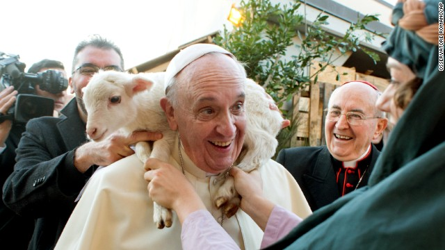<strong>January 6:</strong> A lamb is placed around the neck of Pope Francis as he visits a living nativity scene near Rome for the Epiphany religious holiday.