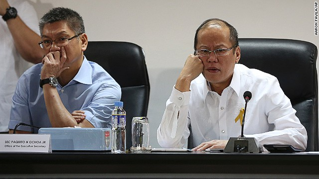 Philippine President Benigno Aquino III, right, and Executive Secretary Paquito Ochoa watch the presentation of officials of the National Disaster Risk Reduction & Management Council in Manila.
