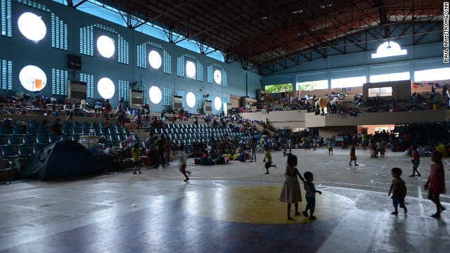 Many in Tacloban have sought shelter in more solid buildings, such as school halls, as a major typhoon threatens the town -- tragically familiar with devastating weather.