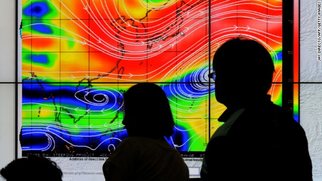 Meteorologists from the Philippine Atmospheric, Geophysical and Astronomical Services Administration plot the direction of Hagupit on Thursday, December 4.
