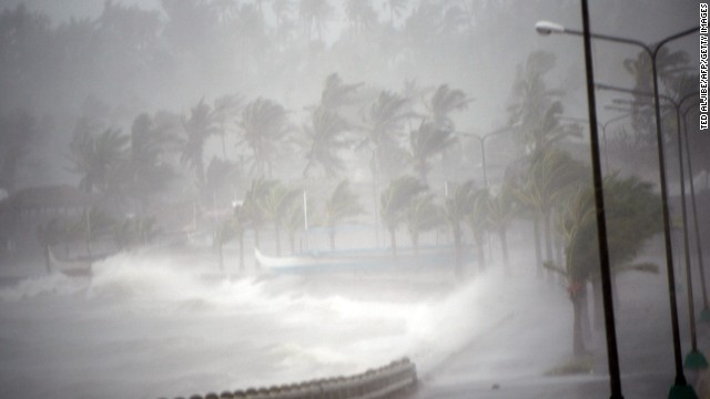 Strong winds and rain pound the seawall in Legazpi, Philippines on December 7. Legazpi could see a foot of rain, in addition to damaging winds.