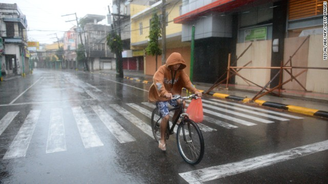 A resident cycles down an empty street before Hagupit passes near Legazpi on December 7.