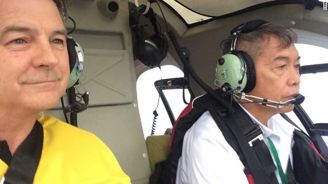 CNN's Andrew Stevens manages a smile despite having to board a helicopter after several hours of commercial flight delays -- as a huge typhoon made its way toward the Philippines.