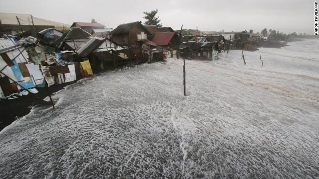 Strong waves crash into coastal houses in Legazpi on December 7.