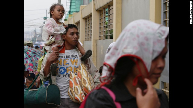 Manila residents evacuate December 8 to safer ground after the local government ordered pre-emptive evacuation in anticipation of Hagupit.