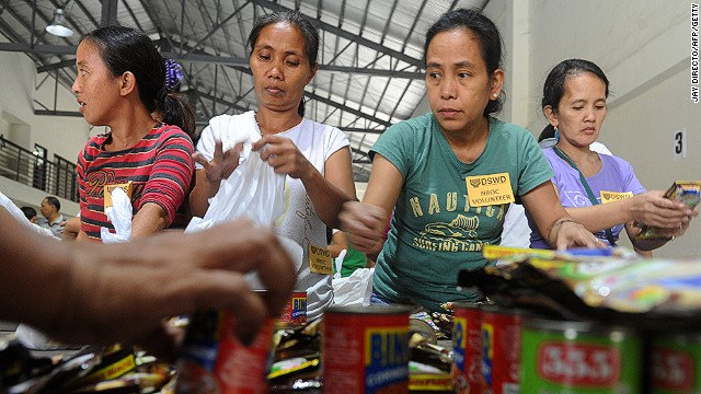 Volunteers repack relief goods in Manila on December 7.