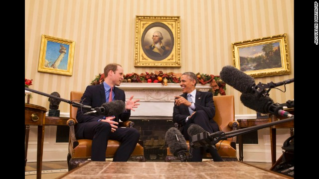U.S. President Barack Obama laughs with Prince William in the Oval Office of the White House on December 8.