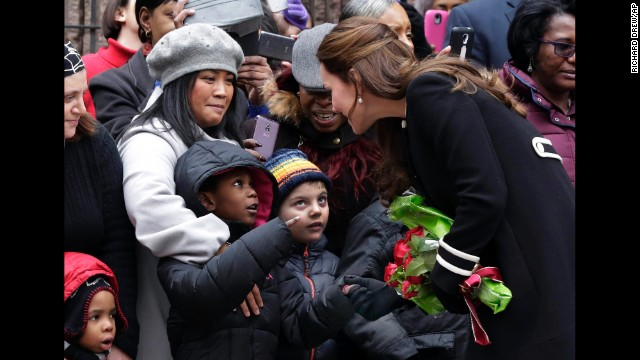 Kate greets children outside of the Northside Center on December 8.