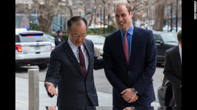 Prince William is greeted by World Bank President Jim Yong Kim before an event December 8 at the World Bank in Washington.
