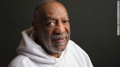 In this Nov. 18, 2013 file photo, actor-comedian Bill Cosby poses for a portrait in New York. A woman who said Friday, Dec. 5, 2014, that Cosby had drugged her and sexually assaulted her in 1979, also accused another famous man of attempted sexual assault: sportscaster Marv Albert, who pleaded guilty to assault and battery the day after her surprise testimony against him.